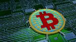 Bitcoin symbol on circuit board